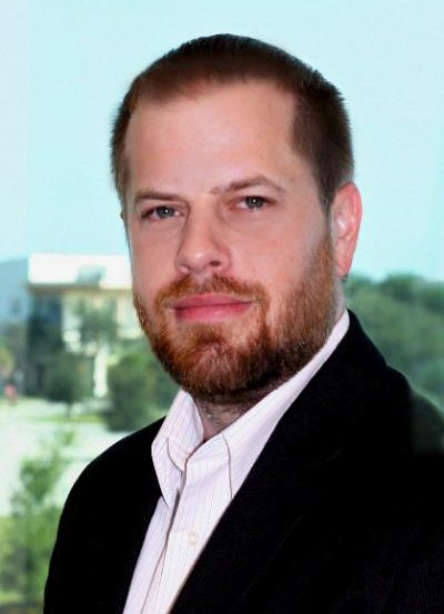 The image shows Seth Tomchik, Ph.D, the lead researcher of this study.