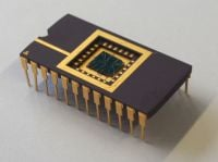 The image shows a computer chip with a built in memristor the researchers used during their research.