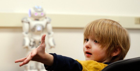 The image shows Aiden with the robot.