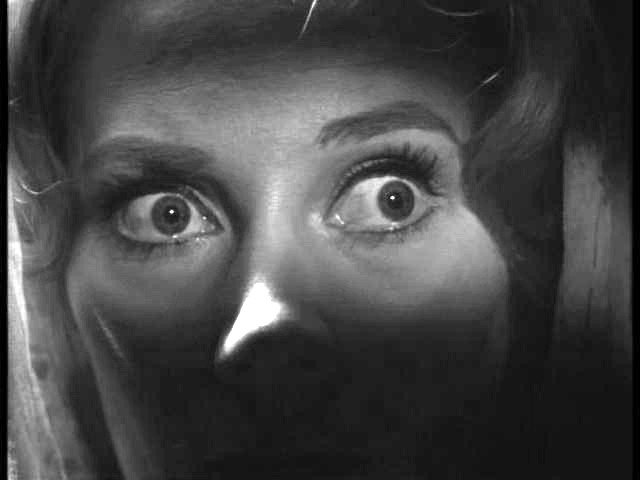 This image shows a scared woman.