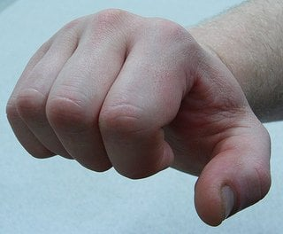 This image shows a fist about to throw a punch.