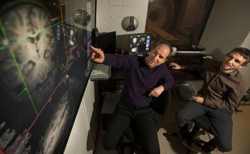 The image shows the researchers looking over data.