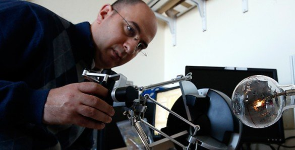 The image shows Nabil Simaan testing a surgical robot that he designed.