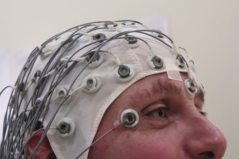 The image shows a person using EEG.
