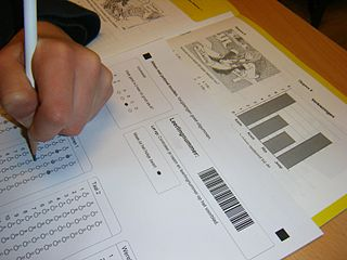This image shows a person filling in a standardized test sheet.