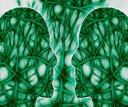 The image shows the outline of two heads surrounded by green neurons.