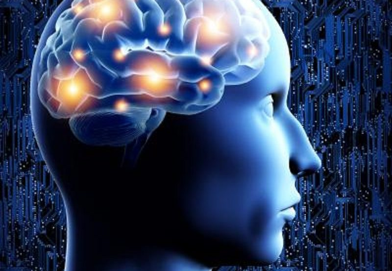 The image shows the outline of a human head with the brain filled with lights.