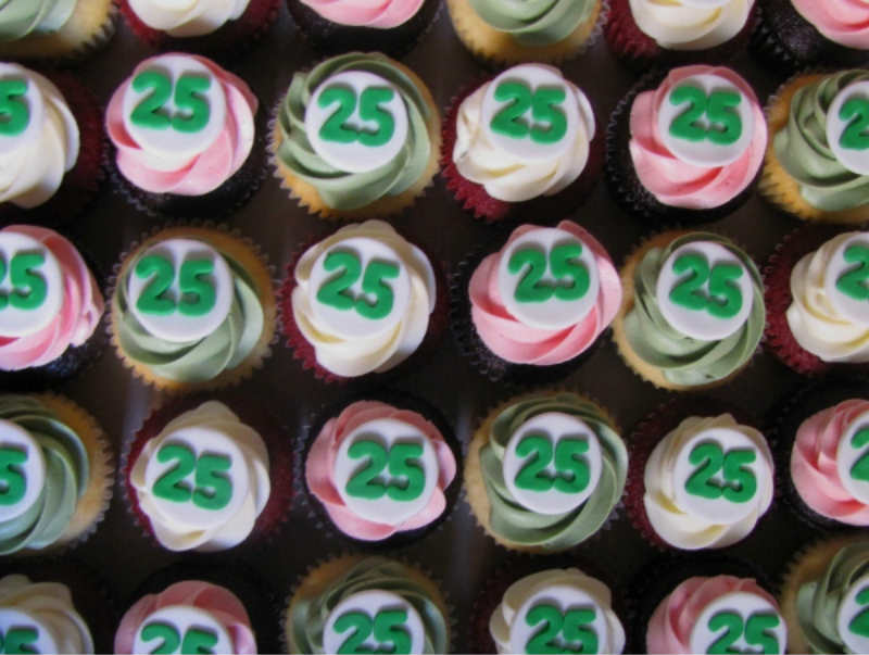 The image shows cupcakes with the number 25 on them.