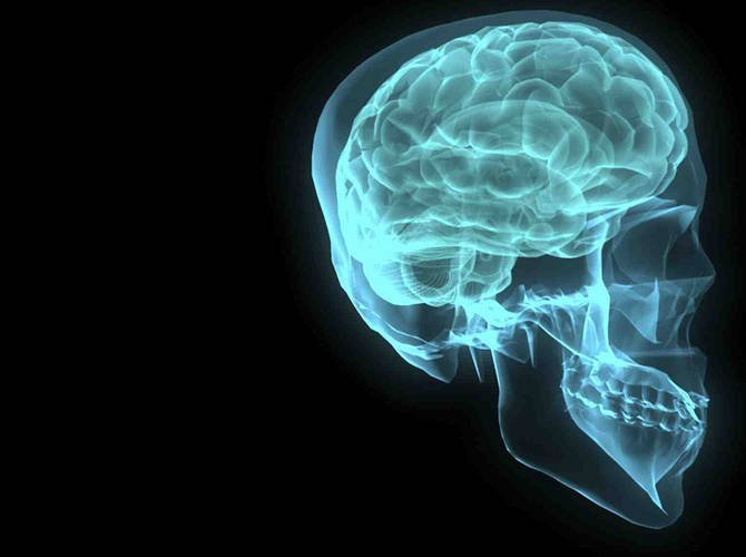This image shows a human head in blue with a neon brain.
