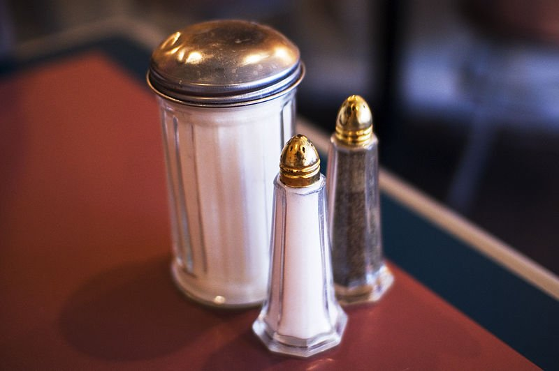 This shows a salt and sugar shaker.