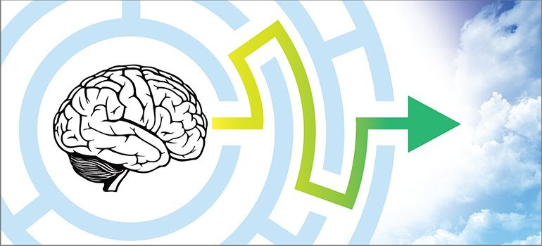 The image shows a brain and a maze.