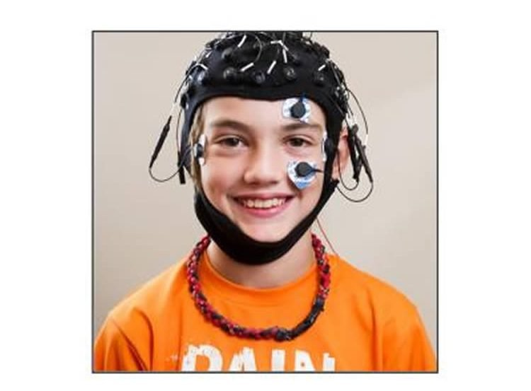 This image shows a child with the EEG headset on.