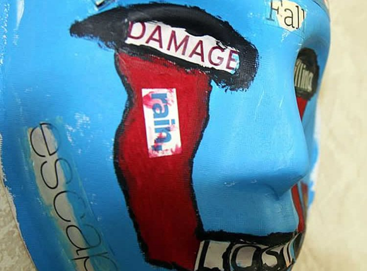 The image shows a mask, painted by a U.S. Marine who attended art therapy to relieve PTSD symptoms.