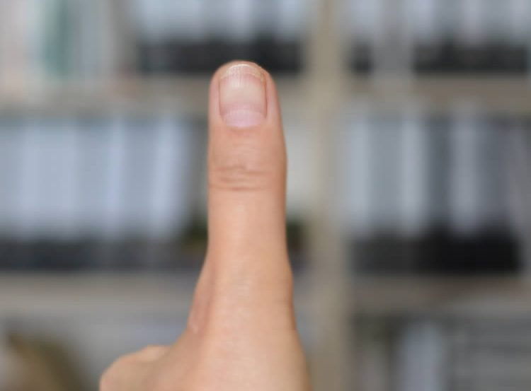 This image shows a person giving the thumbs up.