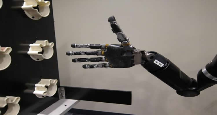 The image shows the robotic hand in a fully flexed position.
