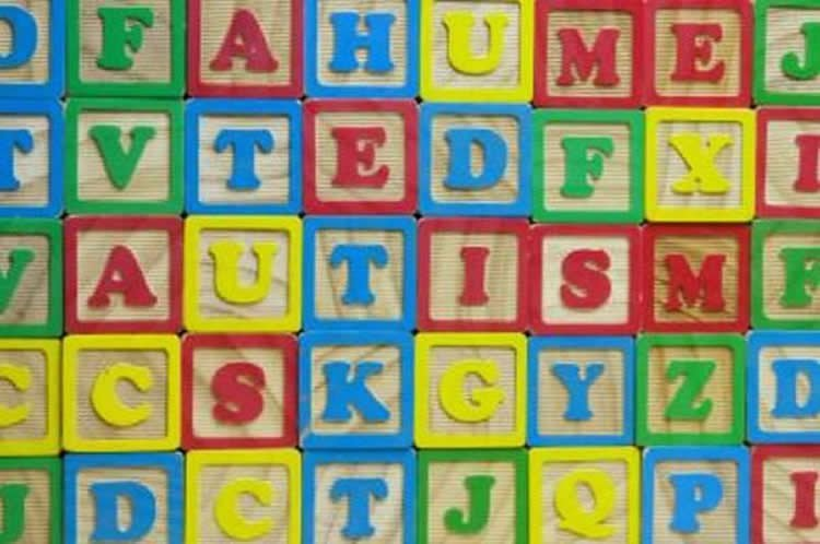 This shows blocks spelling out the word autism.