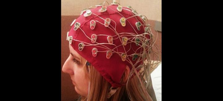 This image shows a woman in an EEG cap.