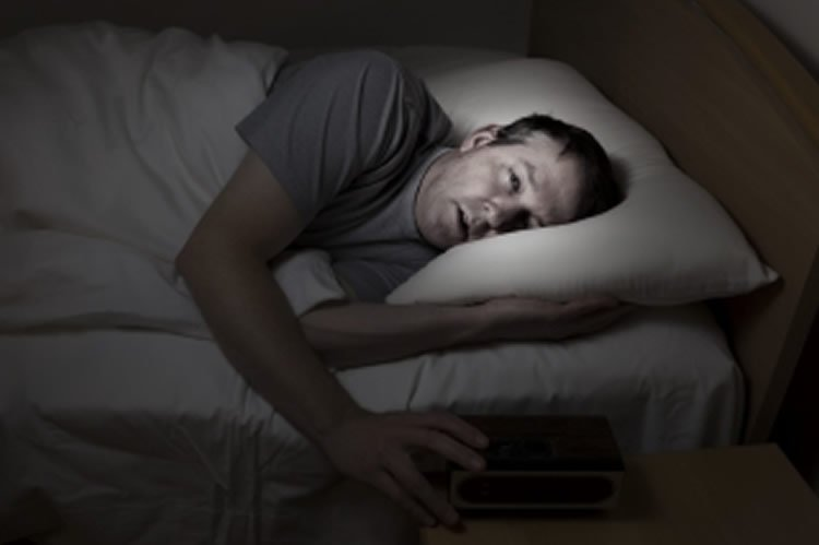 This shows a man trying to sleep.
