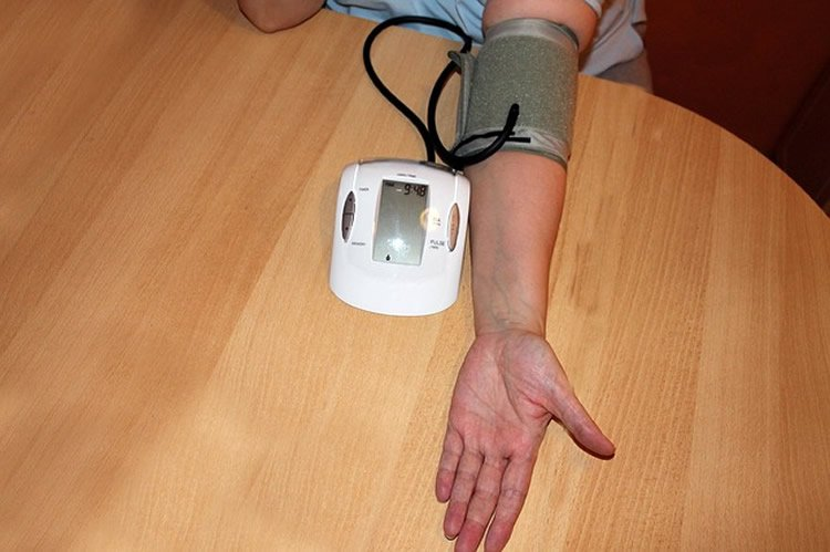 This image shows a person checking their blood pressure.