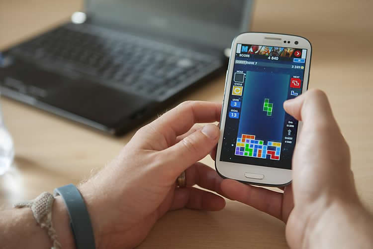 Image shows a person playing tetris.