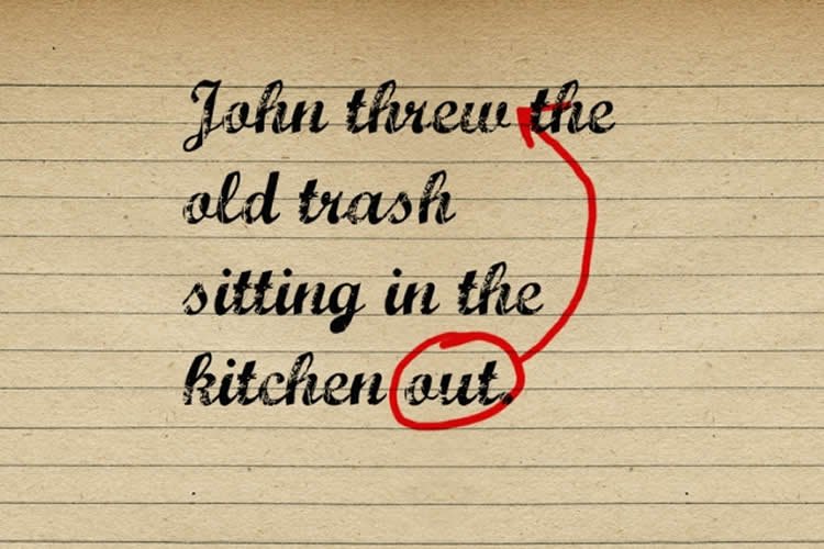 "This is reads ""John threw the old tash sitting in the kitchen out"". The word out is circled in red."
