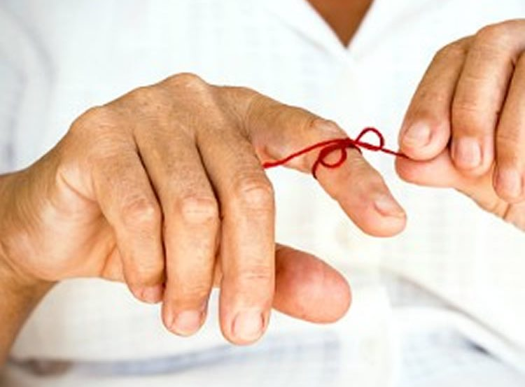 This shows a red ribbon tied around a person's figure.
