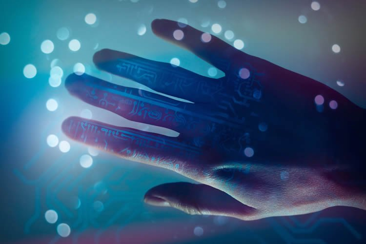 This shows a hand in blue covered in microchips.