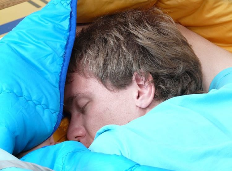Image shows a sleeping man.