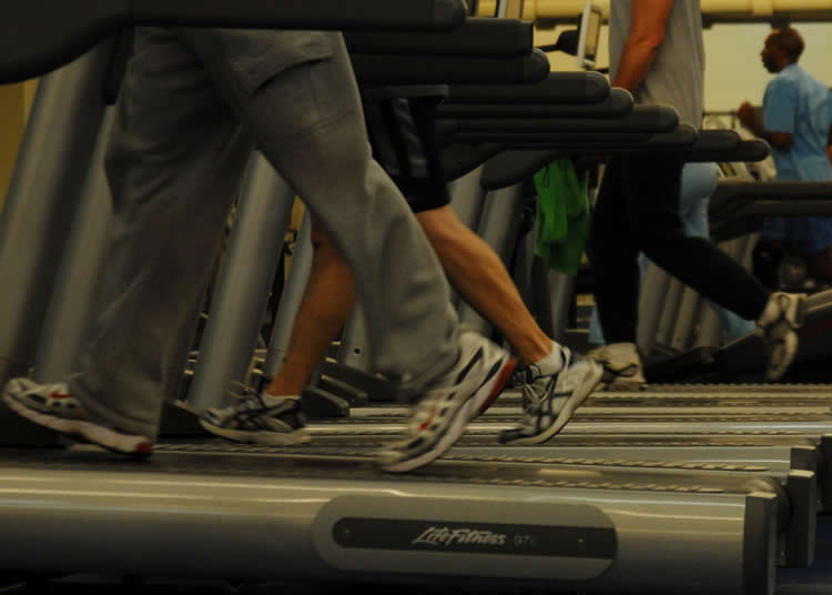Photo of people running on treadmills.