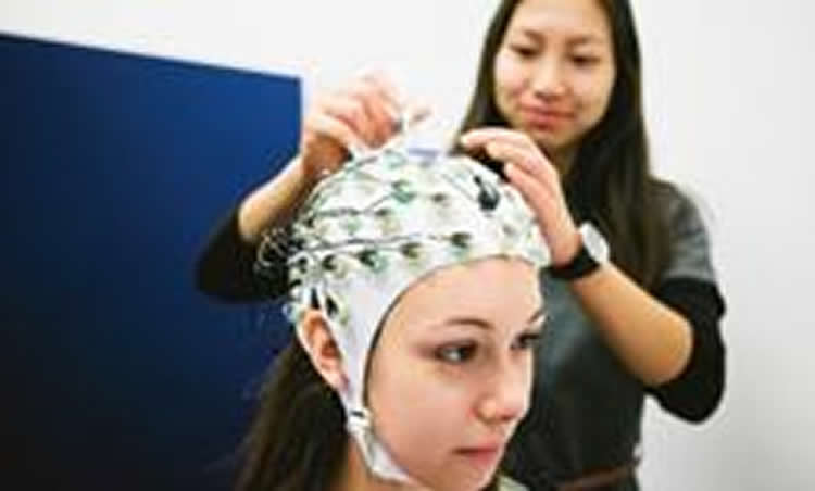 Image of a woman in an eeg cap.