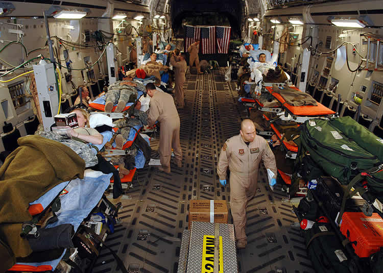 Image shows an aeromedical evacuation of injured patients.