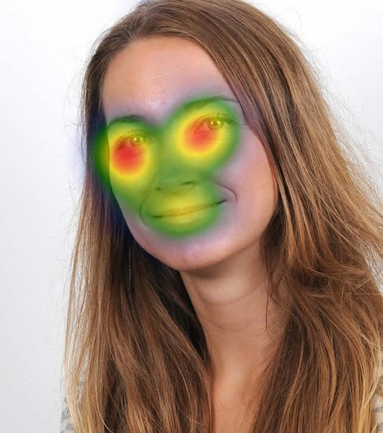 Photo of the researcher with a head map overlaid to show the areas of the face people concentrate on most.