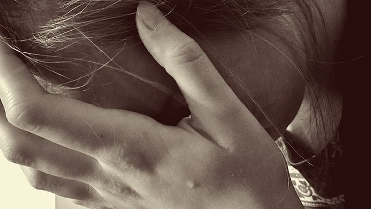 Image shows a girl crying.