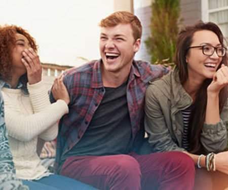 Image of a group of people laughing.