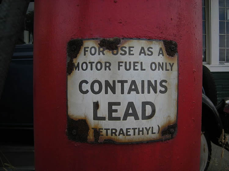 Image shows a sign warning of lead contamination.