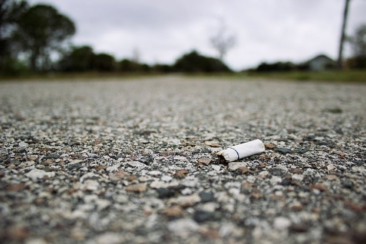 Photo of a stubbed out cigarette.