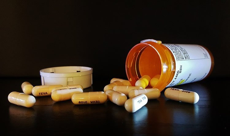 Image shows antibiotic pills.