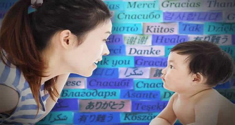 a baby and mom with words in different languages is shown.