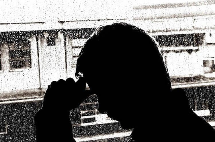 A depressed looking man.