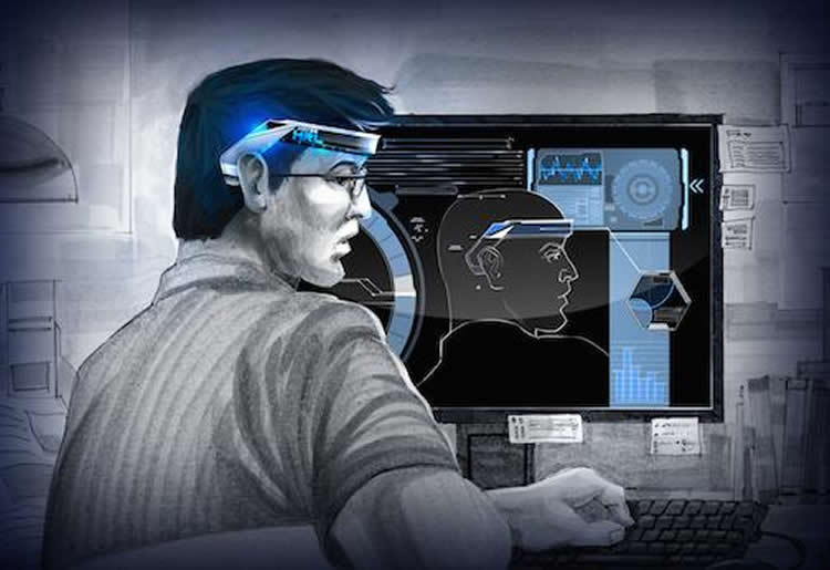 Image of a person in a headset looking at a computer monitor.