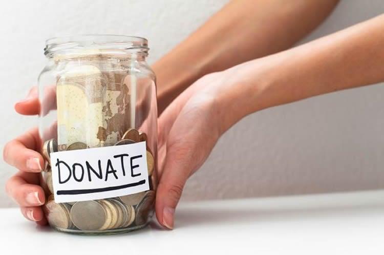 Image shows a donation jar.