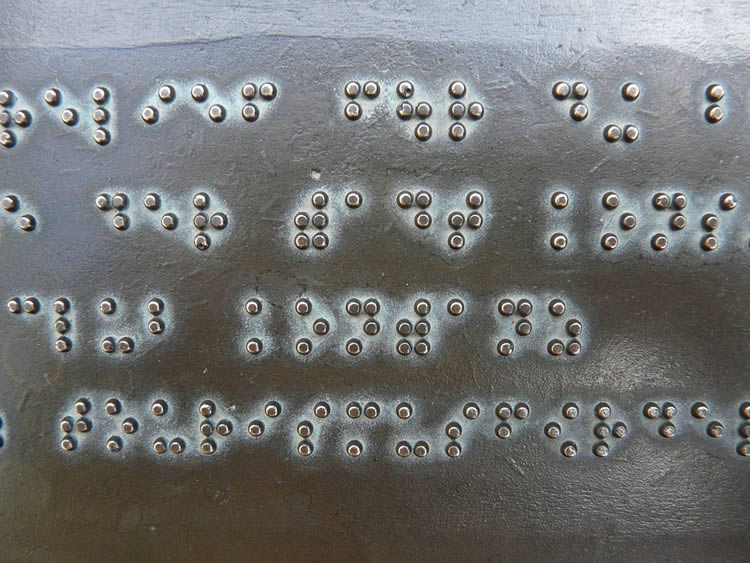 Image shows a sign written in Braille.