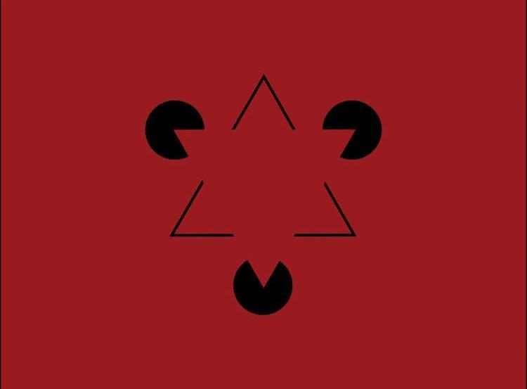 Image of the Kanizsa triangle optical illusion.