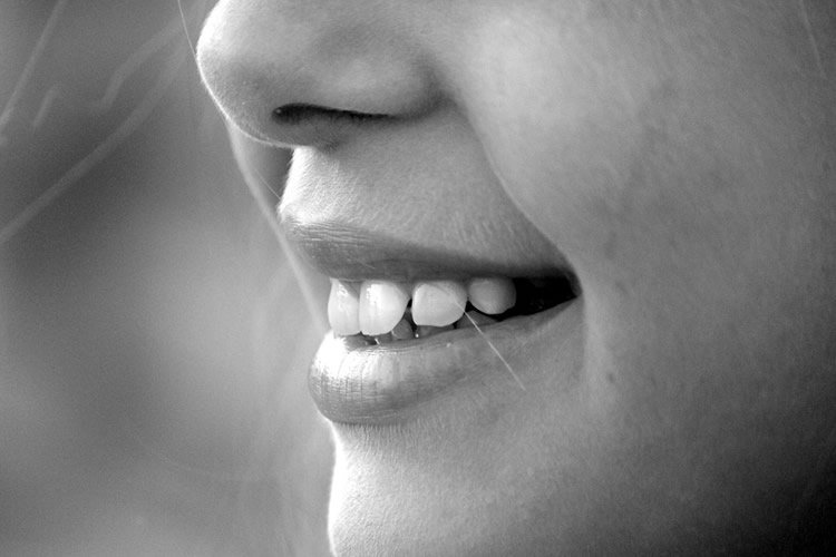 Photo of a woman's mouth.