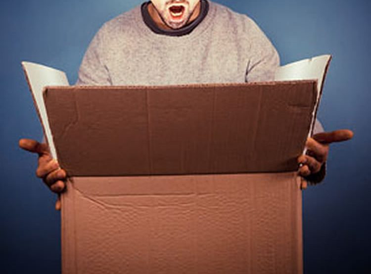 Image shows a man looking into a box.
