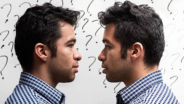 Image shows a man looking at himself.