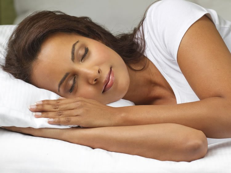Image shows a sleeping woman.