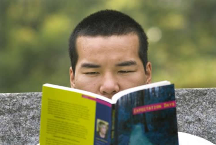 Image of a student reading.