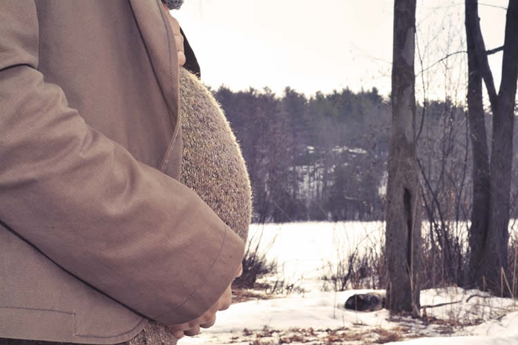 Image shows a pregnant woman.