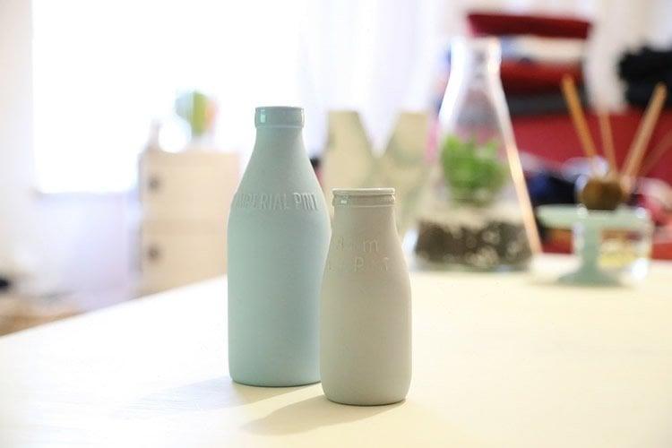 Image shows old fashioned milk bottles.